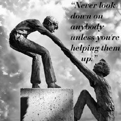 Image statue of one helping another up